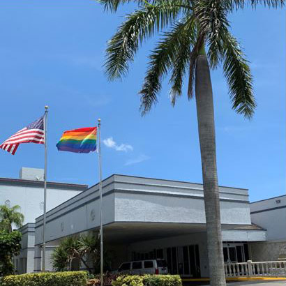 exterior of the Fort Lauderdale Grand Hotel with rainbow flag atop